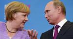 Ahnten sie da schon von den bevorstehenden US-Sanktionen...? Wladimir Putin und Angela Merkel