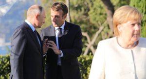 Präsident Putin der franz. Präsident Macron und Kanzlerin Merkel